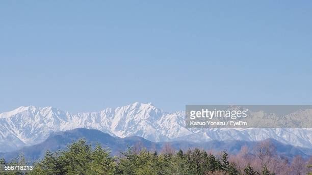 scenic view of snow covered mountains against clear sky - 長野市 ストックフォトと画像