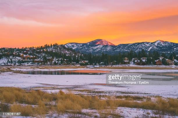 scenic view of snow covered mountains against sky at sunset - san bernardino california stock pictures, royalty-free photos & images