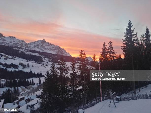 scenic view of snow covered mountains against sky during sunset - alta badia stock pictures, royalty-free photos & images