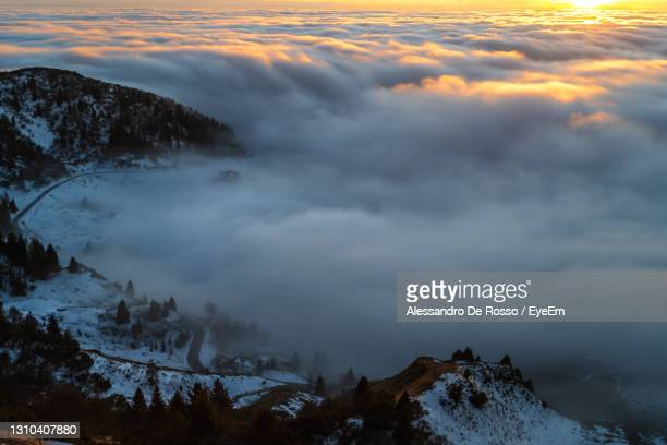 scenic view of snow covered mountains against sky during sunset - kieferngewächse stock-fotos und bilder