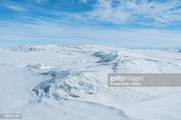 scenic view of snow covered mountains against sky, marinette, wisconsin, united states - frozen stock pictures, royalty-free photos & images