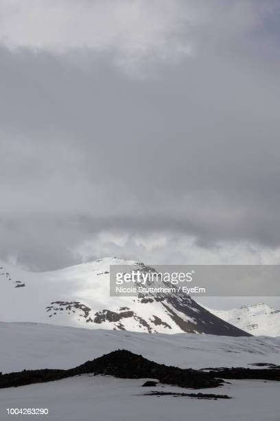 scenic view of snow covered mountains against sky - stutterheim stock photos and pictures