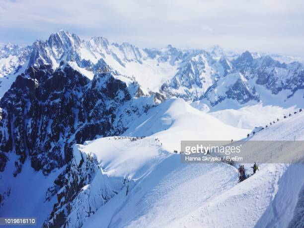 scenic view of snow covered mountains against sky - european alps stock photos and pictures