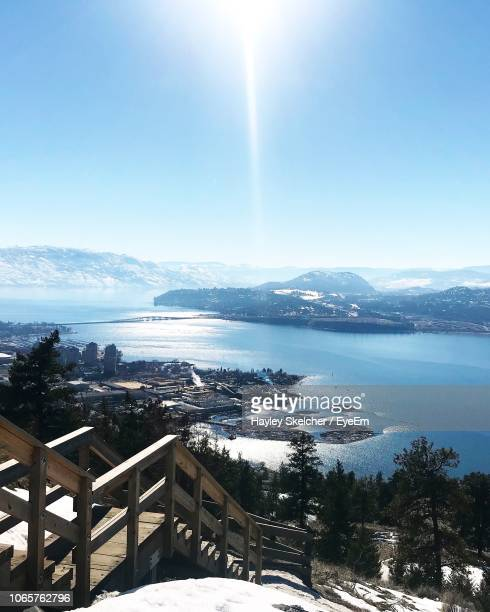 scenic view of snow covered mountains against sky - kelowna stock pictures, royalty-free photos & images