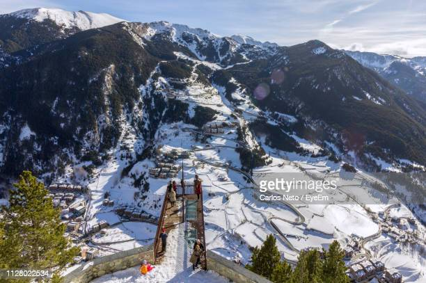 scenic view of snow covered mountains against sky - andorra stock pictures, royalty-free photos & images