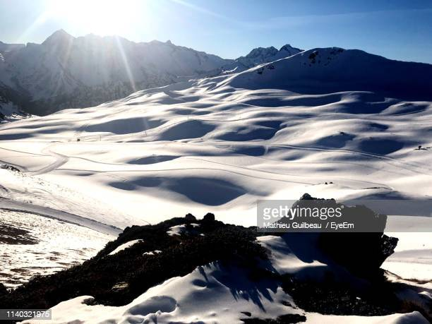 scenic view of snow covered mountains against sky - オートピレネー ストックフォトと画像