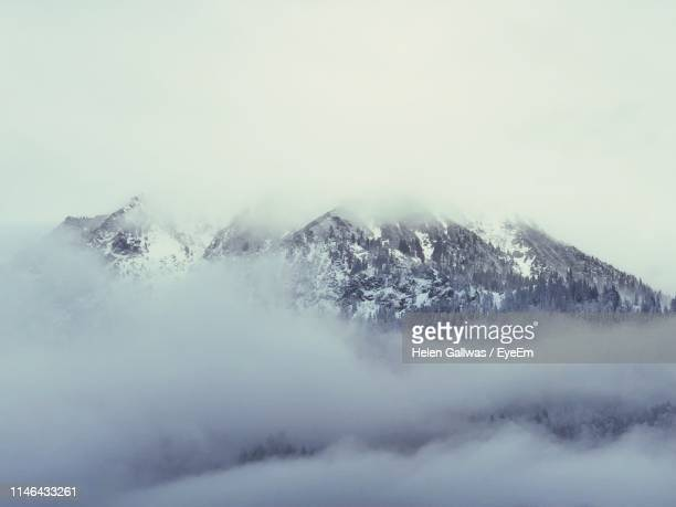 scenic view of snow covered mountains against sky - oberstdorf stock pictures, royalty-free photos & images