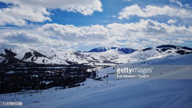 scenic view of snow covered mountains against sky - ketchum idaho stock photos and pictures