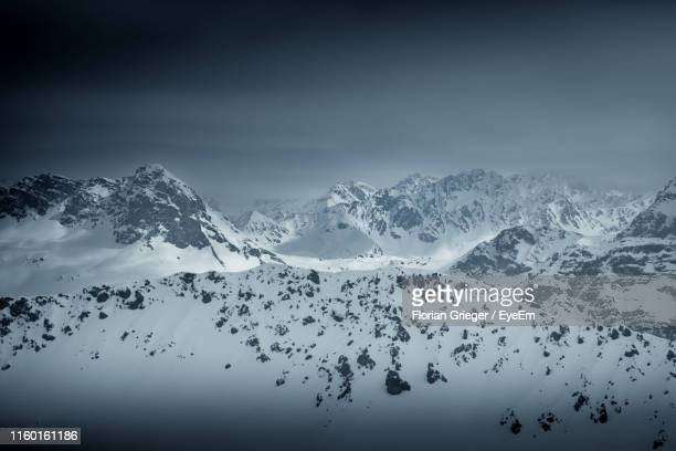 scenic view of snow covered mountains against sky - アロサ ストックフォトと画像