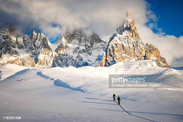 scenic view of snow covered mountains against sky - トレンティーノ ストックフォトと画像