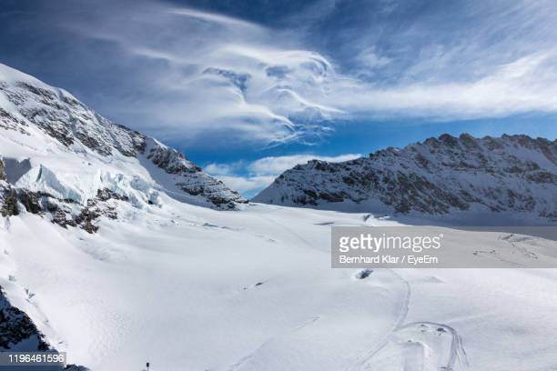 scenic view of snow covered mountains against sky - glacier stock pictures, royalty-free photos & images