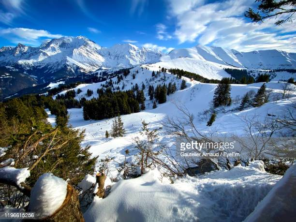 scenic view of snow covered mountains against sky - ムジェーヴ ストックフォトと画像