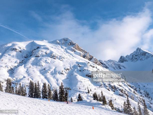 scenic view of snow covered mountains against sky - ゼーフェルト ストックフォトと画像