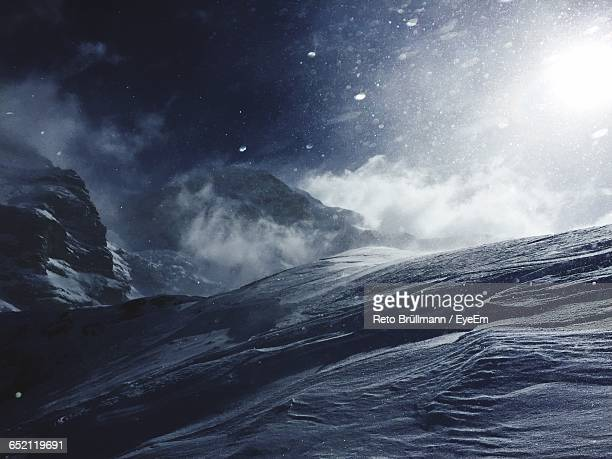 scenic view of snow covered mountains against sky - wetter stock-fotos und bilder