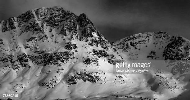 scenic view of snow covered mountains against sky - steve matten stock pictures, royalty-free photos & images