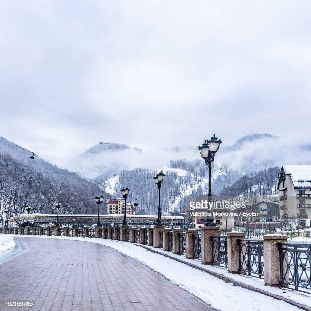 scenic view of snow covered mountains against sky - sochi stock pictures, royalty-free photos & images
