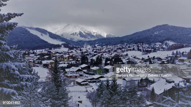 scenic view of snow covered mountains against sky - seefeld stock photos and pictures