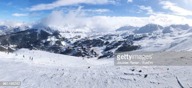 scenic view of snow covered mountains against sky - la plagne stock photos and pictures