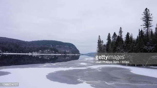 scenic view of snow covered mountains against sky, shawinigan, canada - シャウィニガン ストックフォトと画像