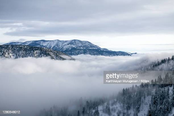 scenic view of snow covered mountains against sky,big bear lake,california,united states,usa - big bear lake stock pictures, royalty-free photos & images