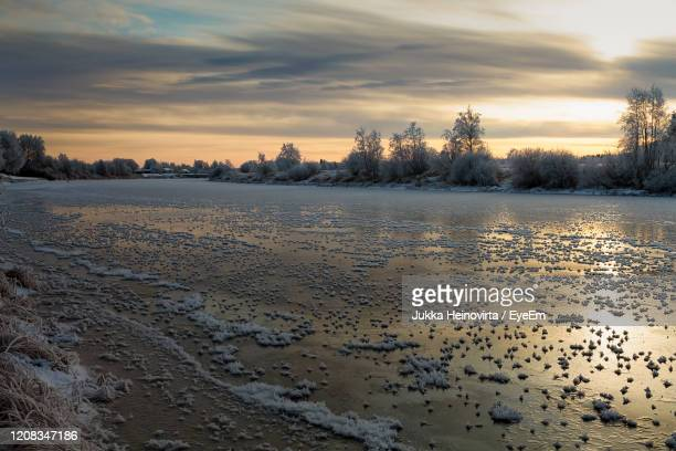 scenic view of snow covered trees against sky during sunset - heinovirta stock pictures, royalty-free photos & images