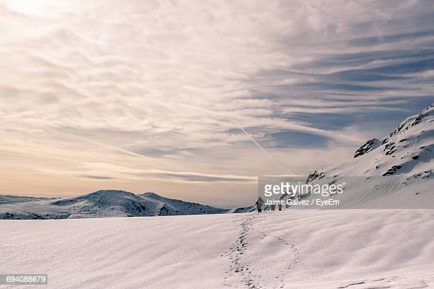 Scenic View Of Snow Landscape Against Sky During Sunset