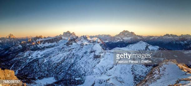 scenic view of snow mountains against sky during sunset - fabrizio penso foto e immagini stock
