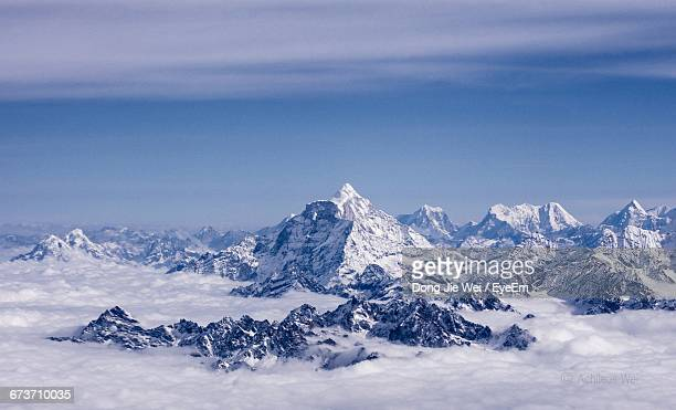 Scenic View Of Snowcapped Ama Dablam Mountains Against Cloudy Sky