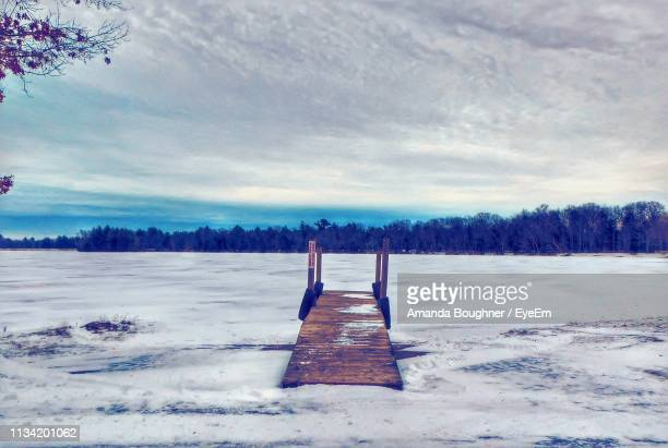 scenic view of snowcapped field against sky - amanda and amanda stock pictures, royalty-free photos & images