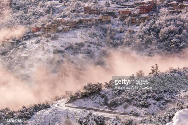 scenic view of snowcapped landscape in foggy weather - algeria stock pictures, royalty-free photos & images