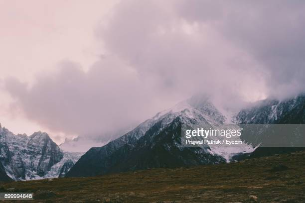 Scenic View Of Snowcapped Mountain Against Cloudy Sky