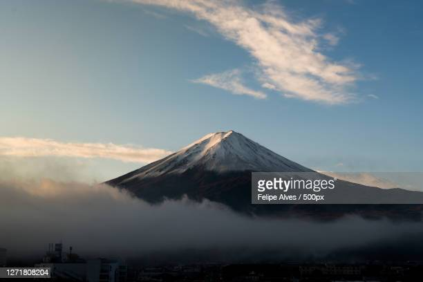 scenic view of snowcapped mountain against sky, kawaguchi, japan - images ストックフォトと画像