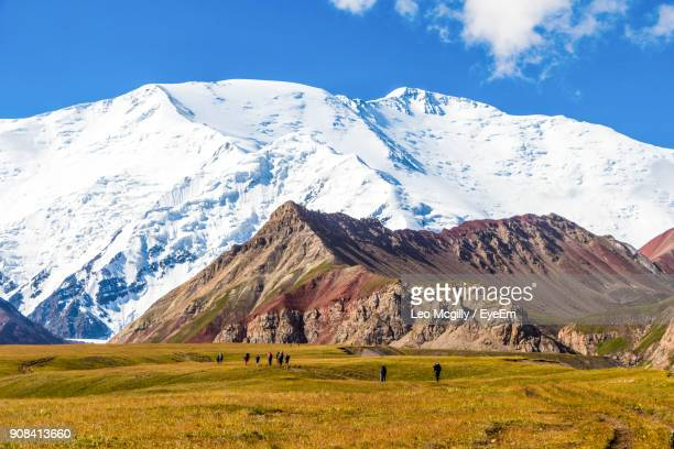 scenic view of snowcapped mountain against sky - kyrgyzstan stock pictures, royalty-free photos & images