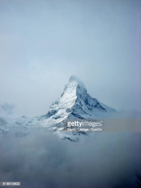 scenic view of snowcapped mountain against sky - matterhorn stock pictures, royalty-free photos & images