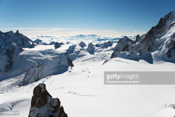 scenic view of snow-capped mountain peaks - high section stock pictures, royalty-free photos & images