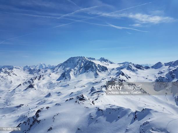 scenic view of snowcapped mountains against blue sky - eyeem stock pictures, royalty-free photos & images