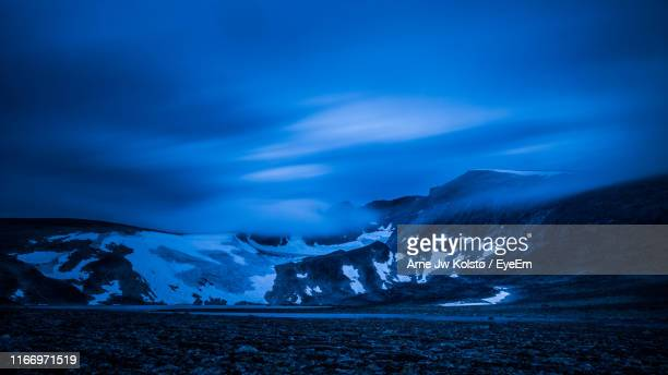 scenic view of snowcapped mountains against blue sky - arne jw kolstø stock pictures, royalty-free photos & images