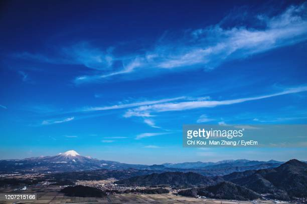 scenic view of snowcapped mountains against blue sky - yonago stock pictures, royalty-free photos & images