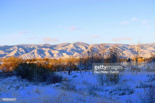 scenic view of snowcapped mountains against blue sky - highlands ranch colorado stock pictures, royalty-free photos & images