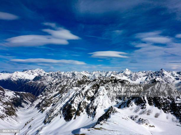 scenic view of snowcapped mountains against blue sky - keiffer ストックフォトと画像