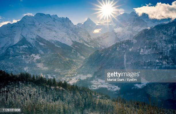 scenic view of snowcapped mountains against bright sky - martial stock pictures, royalty-free photos & images
