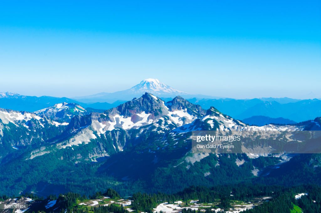 Scenic View Of Snowcapped Mountains Against Clear Blue Sky : Stock Photo