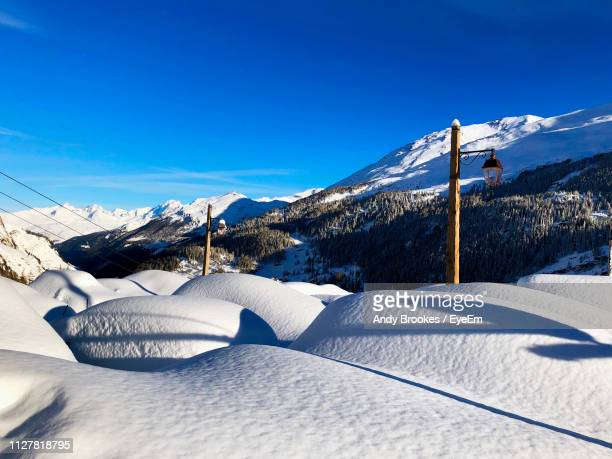 scenic view of snowcapped mountains against clear blue sky - ティーニュ ストックフォトと画像