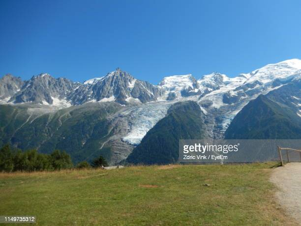 scenic view of snowcapped mountains against clear blue sky - haute savoie fotografías e imágenes de stock