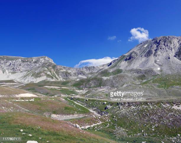 scenic view of snowcapped mountains against clear blue sky - カンポ・インペラトーレ ストックフォトと画像