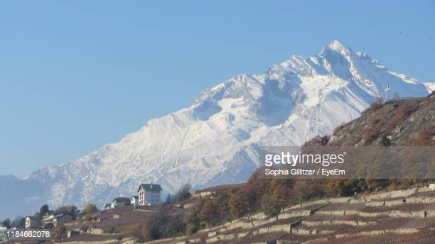 scenic view of snowcapped mountains against clear blue sky - sion switzerland stock pictures, royalty-free photos & images