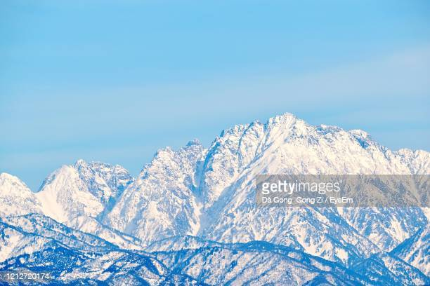 scenic view of snowcapped mountains against clear blue sky - 富山県 ストックフォトと画像