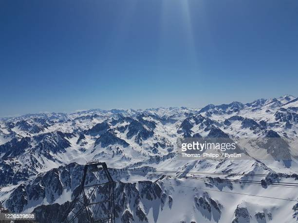 scenic view of snowcapped mountains against clear blue sky - バニェールドビゴール ストックフォトと画像