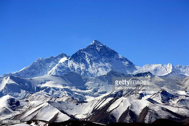 scenic view of snowcapped mountains against clear blue sky - mt. everest stock pictures, royalty-free photos & images