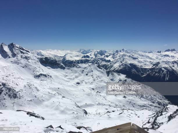 scenic view of snowcapped mountains against clear blue sky - val thorens stock pictures, royalty-free photos & images